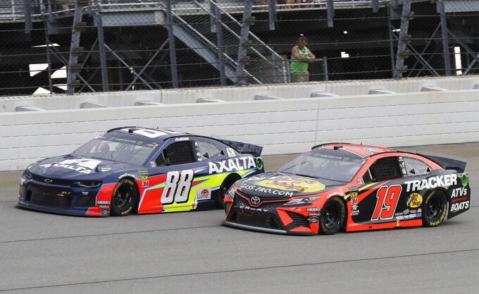 Alex Bowman, left, and Martin Truex Jr., compete during a NASCAR Cup Series auto race at Chicagoland Speedway in Joliet, Ill., Sunday, June 30, 2019. (AP Photo/Nam Y. Huh)