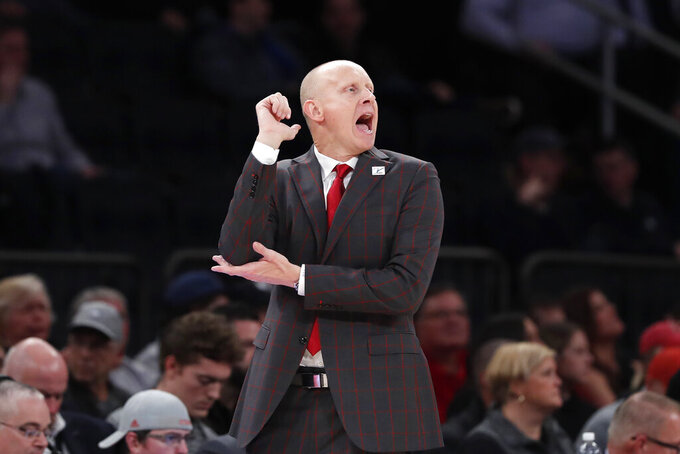 Louisville head coach Chris Mack works the sideline during the first half of an NCAA college basketball game against Texas Tech in the Jimmy V Classic, Tuesday, Dec. 10, 2019, in New York. (AP Photo/Kathy Willens)