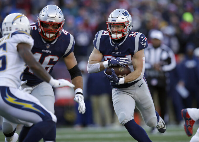 New England Patriots running back Rex Burkhead runs toward the goal line for a touchdown against the Los Angeles Chargers during the first half of an NFL divisional playoff football game, Sunday, Jan. 13, 2019, in Foxborough, Mass. (AP Photo/Charles Krupa)