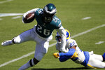 Philadelphia Eagles' Miles Sanders (26) runs past Los Angeles Rams' Troy Hill (22) during the first half of an NFL football game, Sunday, Sept. 20, 2020, in Philadelphia. (AP Photo/Laurence Kesterson)