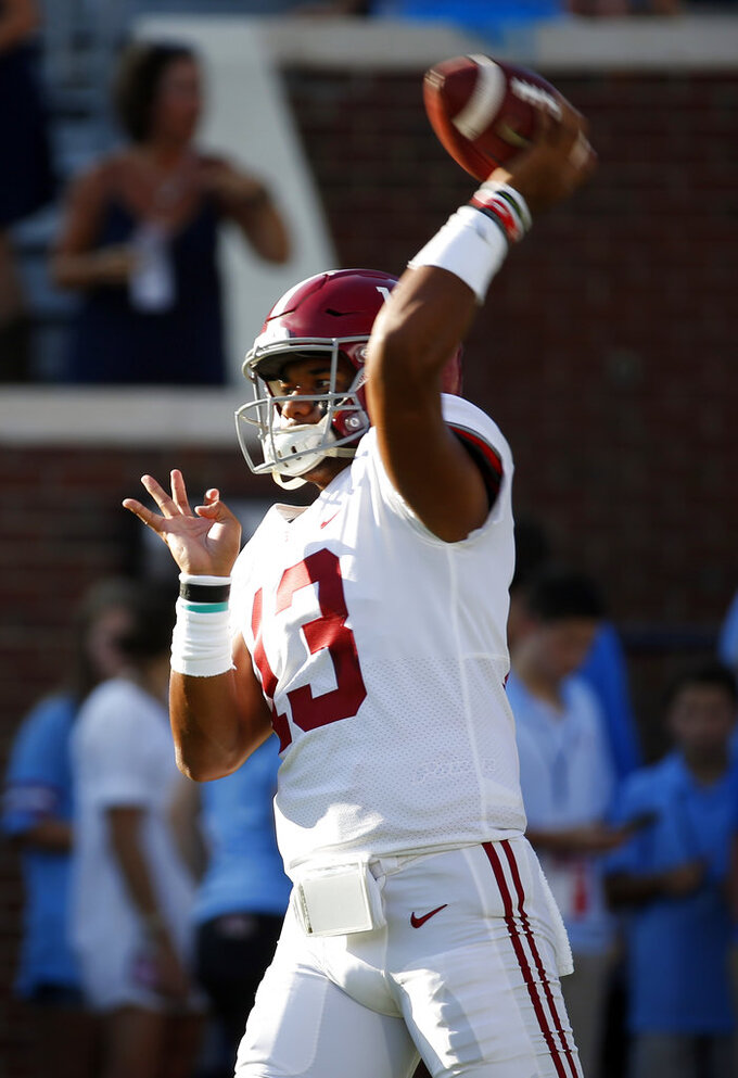 Alabama quarterback Tua Tagovailoa (13) passes the football during the pregame warmup of their NCAA college football game against Mississippi on Saturday, Sept. 15, 2018, in Oxford, Miss. (AP Photo/Rogelio V. Solis)