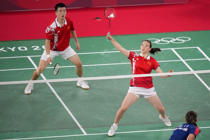 China's Zheng Si Wei, left, and Huang Ya Qiong play against Hong Kong's Tang Chun Man and Tse Ying Suet during their mixed doubles semifinal matchat the 2020 Summer Olympics, Thursday, July 29, 2021, in Tokyo, Japan. (AP Photo/Dita Alangkara)