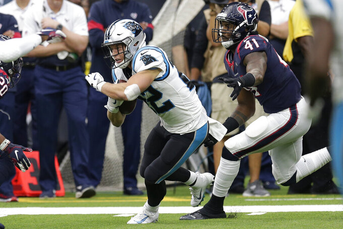 Carolina Panthers running back Christian McCaffrey (22) runs past Houston Texans inside linebacker Zach Cunningham (41) during the first half of an NFL football game Sunday, Sept. 29, 2019, in Houston. (AP Photo/Michael Wyke)