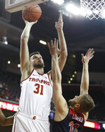 Southern California's Nick Rakocevic shoots over Arizona's Ryan Luther during the first half of an NCAA college basketball game Thursday, Jan. 24, 2019, in Los Angeles. (AP Photo/Jae C. Hong)