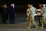President Donald Trump and first lady Melania Trump watch as a U.S. Army carry team moves a transfer case containing the remains of Chief Warrant Officer 2 Kirk T. Fuchigami Jr. of Keaau, Hawaii, Thursday, Nov. 21, 2019, at Dover Air Force Base, Del. According to the Department of Defense, Fuchigami died in Afghanistan when his helicopter crashed while providing security for troops on the ground in eastern Logar Province. (AP Photo/ Evan Vucci)