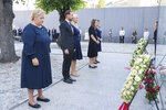 Norway's Prime Minister Erna Solberg, Crown Prince Haakon Magnus, Crown Princess Mette-Marit, AUF leader Astrid Hoem and leader of the National Support Group Lisbeth Kristine Royneland attend a memorial service marking the 10-year anniversary of the terrorist attack by Anders Breivik, in the Government Quarter, Oslo, Thursday, July 22, 2021. Commemorations will be held marking the 10-year anniversary of Norway's worst ever peacetime slaughter. On July 22, 2011, rightwing terrorist Anders Breivik set of a bomb in the capital, Oslo, killing eight people, before heading to tiny Utoya island where he stalked and shot dead 69 mostly teen members of the Labor Party youth wing. (Geir Olsen/NTB scanpix via AP)