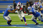 Buffalo Bills running back Devin Singletary (26) rushes during the first half of a preseason NFL football game against the Detroit Lions, Friday, Aug. 13, 2021, in Detroit. (AP Photo/Paul Sancya)