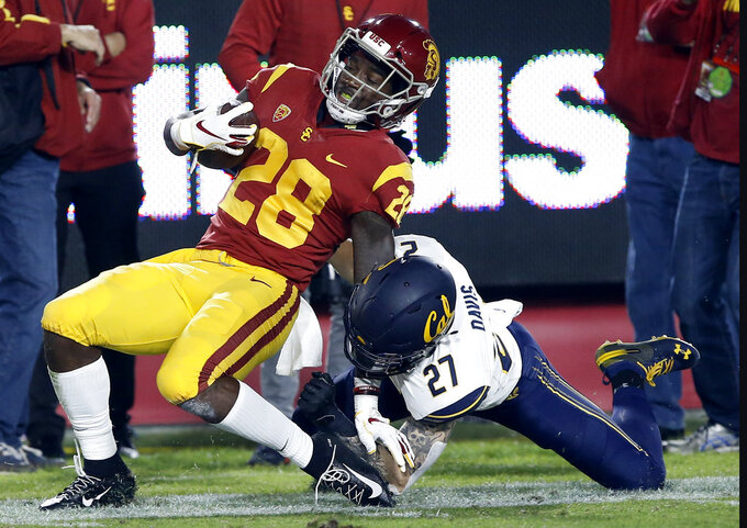 Southern California running back Aca'Cedric Ware, left, is pulled down from behind by California safety Ashtyn Davis (27) after a long run during the first half of an NCAA college football game in Los Angeles, Saturday, Nov. 10, 2018. (AP Photo/Alex Gallardo)