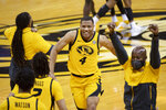 Missouri's Javon Pickett celebrates with teammates after Missouri defeated Illinois 81-78 in an NCAA college basketball game Saturday, Dec. 12, 2020, in Columbia, Mo. (AP Photo/L.G. Patterson)