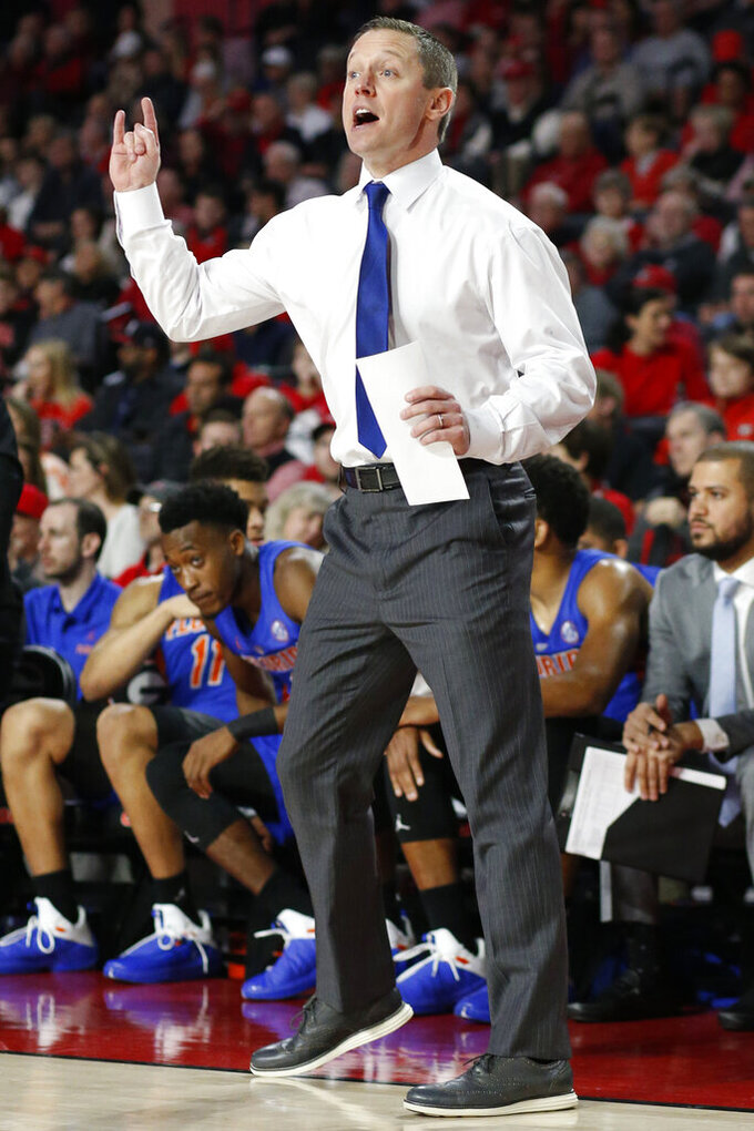Florida coach Mike White directs his team during an NCAA college college basketball game against Georgia in Athens, Ga., on Saturday, Jan. 19, 2019.  ( Joshua L. Jones/Athens Banner-Herald via AP)