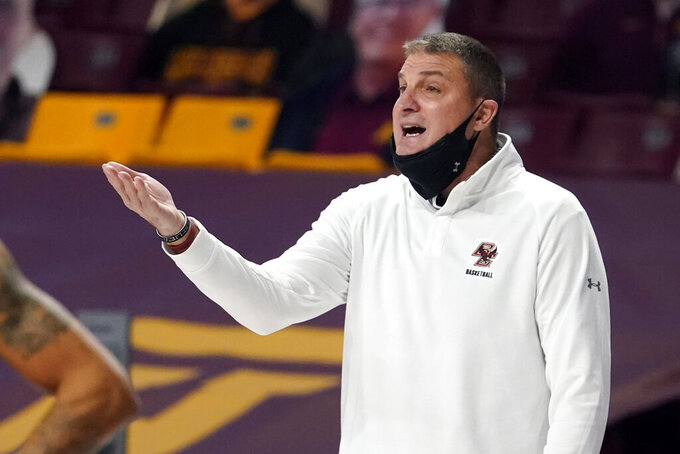 Boston College coach Jim Christian gestures during the first half of the team's NCAA college basketball game against Minnesota on Tuesday, Dec. 8, 2020, in Minneapolis. (AP Photo/Jim Mone)