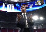 FILE - In this Jan. 29, 2019, file photo, NFL Chief Medical Officer Dr. Allen Sills gestures while speaking during a health and safety tour at Mercedes-Benz Stadium for the NFL Super Bowl 53 football game in Atlanta. Sills says the league is establishing a new two-step protocol for player and coaches who have no known history of the COVID infection and receive a positive test. He said any individual in that circumstance and who is also asymptomatic will then be given two confirmatory tests on the day following the positive test result. (AP Photo/David J. Phillip, File)