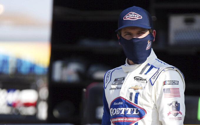 Brennan Poole walks to his race car before a NASCAR Cup Series auto race Sunday, Sept. 27, 2020, in Las Vegas. (AP Photo/Isaac Brekken)