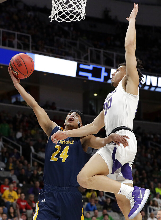 UC Irvine guard Eyassu Worku (24) shoots against Kansas State guard Mike McGuirl during the second half of a first-round game in the NCAA men's college basketball tournament Friday, March 22, 2019, in San Jose, Calif. (AP Photo/Chris Carlson)