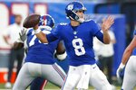 FILE - In this Sunday, Aug. 29, 2021, file photo, New York Giants quarterback Daniel Jones (8) throws a pass during the first half of an NFL preseason football game against the New England Patriots in East Rutherford, N.J. The Giants take on the Denver Broncos on Sunday. (AP Photo/Noah K. Murray, File)