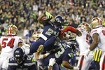 Seattle Seahawks' Marshawn Lynch (24) scores a touchdown on a 1-yard rush against the San Francisco 49ers during the second half of an NFL football game, Sunday, Dec. 29, 2019, in Seattle. (AP Photo/Stephen Brashear)