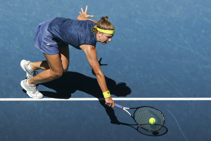 Karolina Muchova of the Czech Republic hits a backhand return to Australia's Ash Barty during their quarterfinal match at the Australian Open tennis championship in Melbourne, Australia, Wednesday, Feb. 17, 2021.(AP Photo/Hamish Blair)