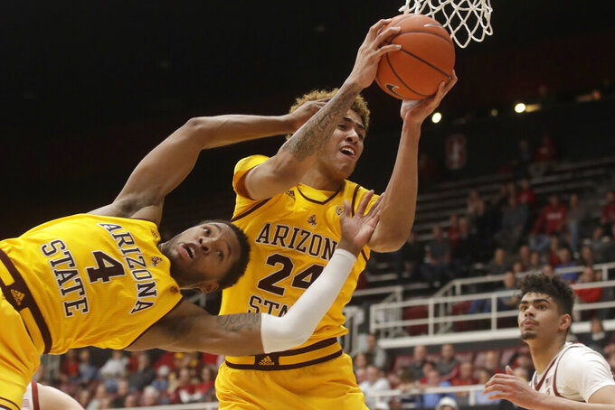 Arizona State forward Jalen Graham (24) grabs a rebound over forward Kimani Lawrence (4) during the second half of the team's NCAA college basketball game against Stanford in Stanford, Calif., Thursday, Feb. 13, 2020. (AP Photo/Jeff Chiu)