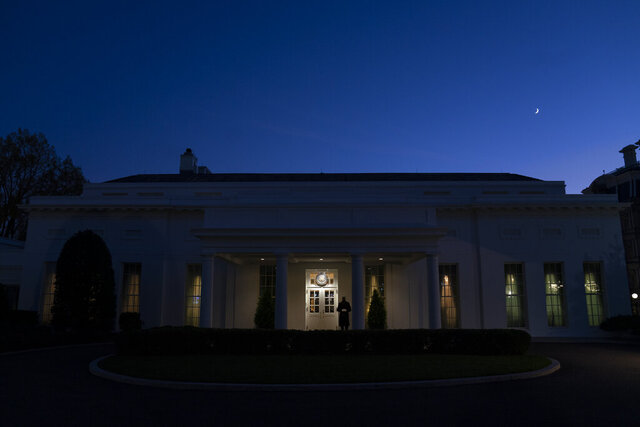 A Marine stands outside the entrance to the West Wing of the White House, signifying that President Donald Trump is in the Oval Office, Wednesday, Nov. 18, 2020, in Washington. (AP Photo/Evan Vucci)