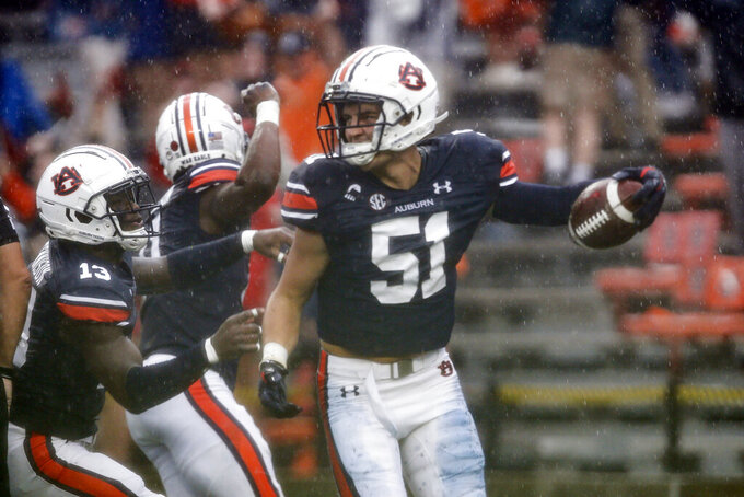 Auburn linebacker Barton Lester (51) celebrates after recovering a blocked punt for a touchdown during the first quarter of an NCAA college football game against Arkansas on Saturday, Oct. 10, 2020, in Auburn, Ala. (AP Photo/Butch Dill)