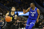 Marquette's Markus Howard, left, drives to the basket against Seton Hall's Quincy McKnight during the first half of an NCAA college basketball game Saturday, Feb. 29, 2020, in Milwaukee. (AP Photo/Aaron Gash)