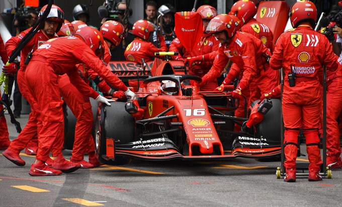 Technicians push the car of Ferrari's Monegasque driver Charles Leclerc in the pits during the Monaco Formula One Grand Prix race, at the Monaco racetrack, in Monaco, Sunday, May 26, 2019. (Yann Coatsaliou/Pool Photo via AP)