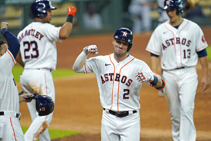 Houston Astros' Alex Bregman (2) celebrates after hitting a three-run home run against the Seattle Mariners during the third inning of a baseball game Monday, July 27, 2020, in Houston. (AP Photo/David J. Phillip)