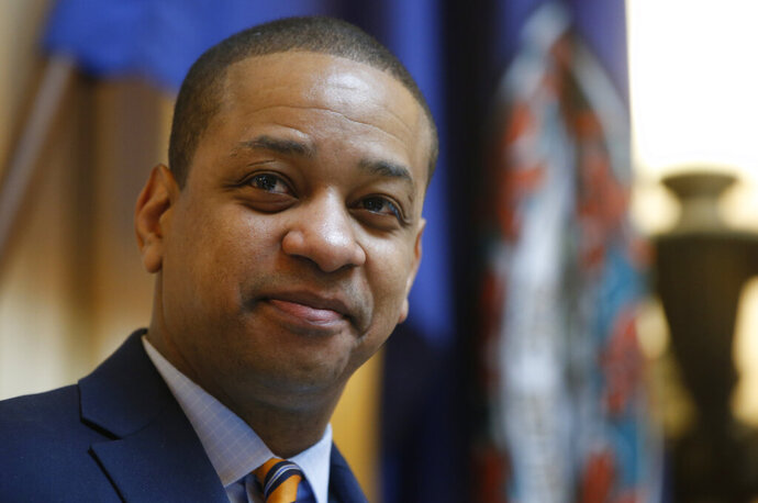 FILE -  In this Feb. 14, 2019 file photo Virginia Lt. Gov. Justin Fairfax presides over the Senate during the session at the Capitol in Richmond, Va. Fairfax filed a $400 million defamation lawsuit Thursday, Sept. 12 against CBS Corp. and CBS Broadcasting in New York, alleging the network published false statements by two women who have accused him of sexual assault. (AP Photo/Steve Helber, File)