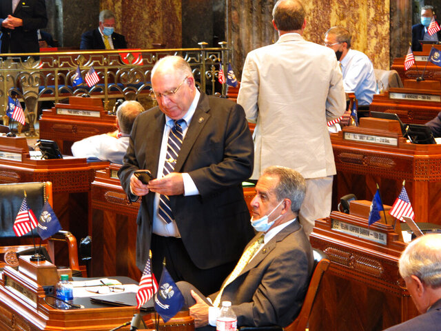 Sen. Mike Fesi, R-Houma, standing, speaks with Sen. Louie Bernard, R-Natchitoches, on the Senate floor in the final hours of Louisiana's special legislative session, on Tuesday, June 30, 2020, in Baton Rouge, La. (AP Photo/Melinda Deslatte) (AP Photo/Melinda Deslatte)