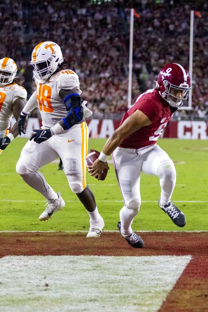 Alabama quarterback Bryce Young (9) runs for a touchdown past Tennessee defensive lineman Ja'Quain Blakely (48) during the first half of an NCAA college football game Saturday, Oct. 23, 2021, in Tuscaloosa, Ala. (AP Photo/Vasha Hunt)