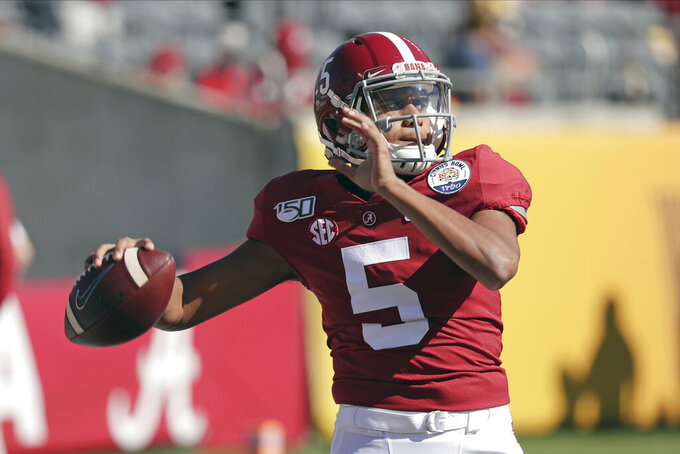 FILE - In this Jan. 1, 2020, file photo, former Alabama quarterback Taulia Tagovailoa warms up before the Citrus Bowl NCAA college football game against Michigan in Orlando, Fla. As head coach Michael Locksley enters his second season as the helm, he deals with quarterback Josh Jackson opting out of the 2020 season because of the COVID-19 pandemic and Tyrrell Pigrome has transferred to Western Kentucky. Tagovailoa, an Alabama transfer, and redshirt freshman Lance Legendre have been competing for the starting spot this fall.(AP Photo/John Raoux, File)