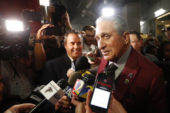 "FILE - In this Oct. 27, 2019 file photo, Atlanta Falcons owner Arthur Blank speaks to the media after an NFL football game between the Atlanta Falcons and the Seattle Seahawks in Atlanta.  Blank's support of the movement to bring attention to social injustice has been celebrated by his Atlanta Falcons players.  Blank devoted a chapter of his new book ""Good Company"" to social protest, including the NFL's response to San Francisco 49ers quarterback Colin Kaepernick kneeling during the national anthem in 2016.  (AP Photo/John Bazemore, File)"