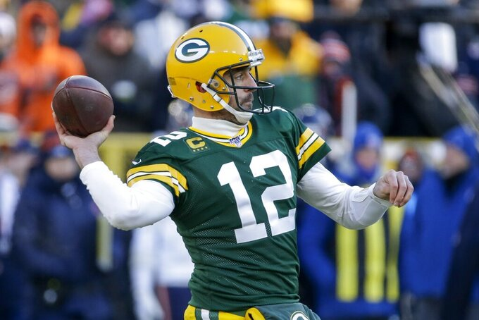 Green Bay Packers' Aaron Rodgers throws during the first half of an NFL football game against the Chicago Bears Sunday, Dec. 15, 2019, in Green Bay, Wis. (AP Photo/Mike Roemer)