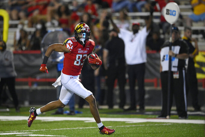 Maryland wide receiver Carlos Carriere (83) carries the ball en route to a touchdown during the second half of an NCAA college football game against Howard, Saturday, Sept. 11, 2021, in College Park, Md. (AP Photo/Nick Wass)