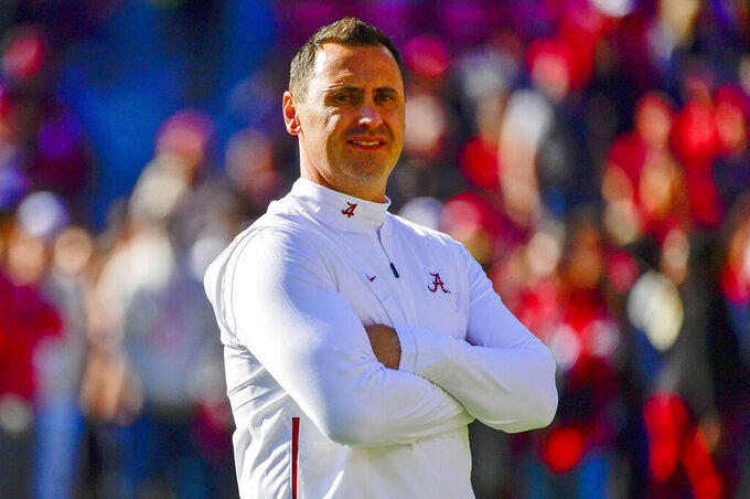 FILE - In this Nov. 9, 2019, file photo, Alabama offensive coordinator Steve Sarkisian watches warmups before an NCAA football game against LSU in Tuscaloosa, Ala. Texas has hired Sarkisian as the Longhorns new coach. The move comes just a few hours after Texas announced the firing of Tom Herman after four seasons with no Big 12 championships. (AP Photo/Vasha Hunt, File)