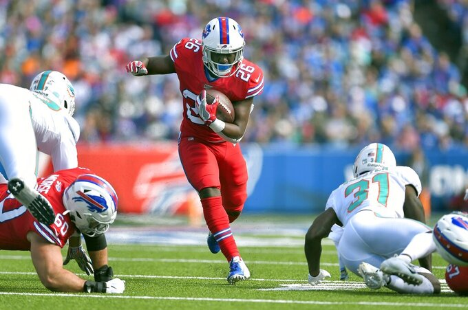 Buffalo Bills running back Devin Singletary carries the ball Miami Dolphins in the first half of an NFL football game, Sunday, Oct. 20, 2019, in Orchard Park, N.Y. (AP Photo/Adrian Kraus)