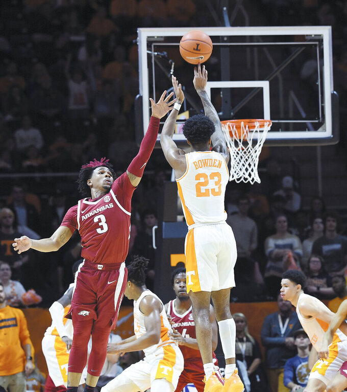 Tennessee's Jordan Bowden (23) sinks a 3-pointer over Arkansas's Desi Sills (3) during an NCAA college basketball game, in Knoxville, Tenn., Tuesday, Feb. 11, 2020. (Scott Keller/The Daily Times via AP)
