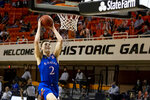 Kansas' Christian Braun goes up for a dunk during the first half of the team's NCAA college basketball game against Oklahoma State in Stillwater, Okla., Tuesday, Jan. 12, 2021. (AP Photo/Mitch Alcala)