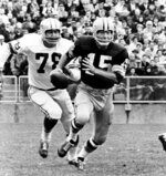 FILE - In this Oct. 2, 1966, file photo, Green Bay quarterback Bart Starr (15) is pursued by Detroit Lions' Darris McCord during a football game in Green Bay, Wisc. Bart Starr, the Green Bay Packers quarterback and catalyst of Vince Lombardi's powerhouse teams of the 1960s, died Sunday, May 26, 2019. He was 85. (AP Photo/File)