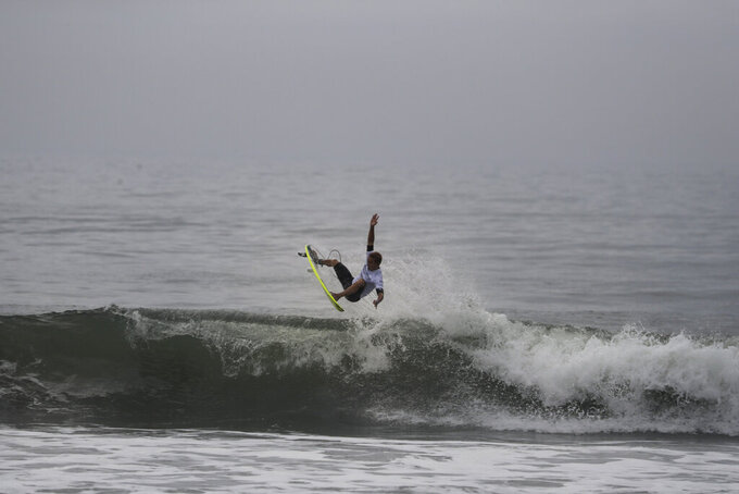 FILE - In this Thursday, July 18, 2019, file photo, a surfer competes during a test event at Tsurigasaki beach, a venue for surfing at the Tokyo 2020 Olympics, in Ichinomiya, Chiba prefecture, east of Tokyo. The International Surfing Association has been lobbying the International Olympic Committee since 1995, though the effort to include the sport dates back to the 1912 Summer Games in Stockholm. (AP Photo/Jae C. Hong, FIle)