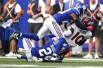 Denver Broncos wide receiver Jerry Jeudy (10) is tackled by New York Giants' Logan Ryan (23) and James Bradberry (24) during the second half of an NFL football game Sunday, Sept. 12, 2021, in East Rutherford, N.J. (AP Photo/Adam Hunger)