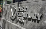 "FILE - This Aug. 1, 2017, file photo shows the 21st Century Fox sign outside of the News Corporation headquarters building in New York. Disney has made a $52.4 billion all-stock offer for the bulk of Twenty-First Century Fox, including the studios behind the ""Avatar"" movies,"