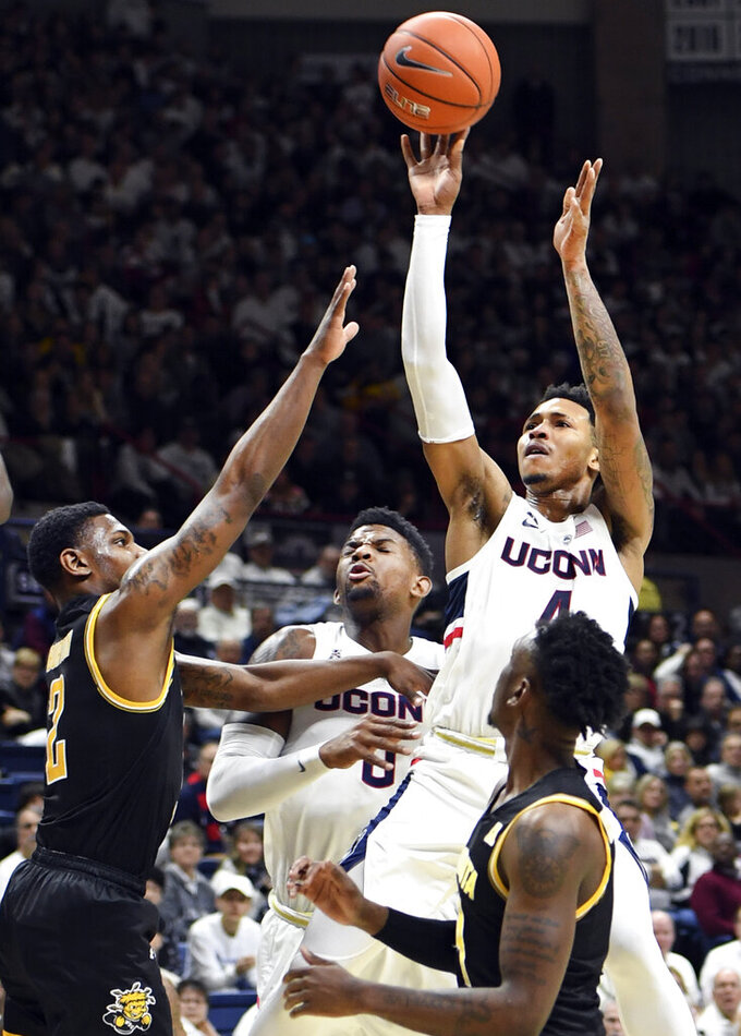 Connecticut's Jalen Adams (4) shoots during the first half of the team's NCAA college basketball game against Wichita State on Saturday, Jan. 26, 2019, in Storrs, Conn. (AP Photo/Stephen Dunn)