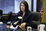 FILE - In this March 5, 2020, file photo, Michigan Attorney General Dana Nessel addresses the media during a news conference in Lansing, Mich. The U.S. Department of Education is attempting to take pandemic relief funds away from K-12 public schools and divert the money to private schools, California and four other states argued in a lawsuit filed Tuesday, July 7, 2020, against the Trump administration. California Attorney General Xavier Becerra and Michigan Attorney General Dana Nessel announced the lawsuit, which was joined by Maine, New Mexico, Wisconsin and the District of Columbia. (AP Photo/David Eggert, File)
