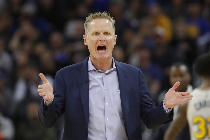 FILE - Golden State Warriors head coach Steve Kerr gestures toward an official during the first half of his team's NBA basketball game against the Toronto Raptors in San Francisco, in this Thursday, March 5, 2020, file photo. Don't press Steve Kerr about last season. He would rather put it completely out of memory and move on for good from a last-place NBA finish and no playoffs following five straight trips to the NBA Finals. (AP Photo/Jeff Chiu, File)
