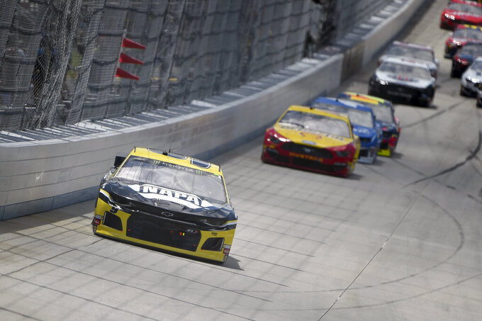 Driver Chase Elliott (9) leads driver Joey Logano (22) during the NASCAR Cup Series auto race, Monday, May 6, 2019, at Dover International Speedway in Dover, Del. (AP Photo/Will Newton)