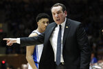 FILE - In this Saturday, March 7, 2020, file photo, Duke head coach Mike Krzyzewski reacts to an official during the second half of an NCAA college basketball game against North Carolina in Durham, N.C. The NCAA's announcement college basketball start date led to huge scramble as schools tried to fill out schedules altered by the coronavirus pandemic. (AP Photo/Gerry Broome, File)