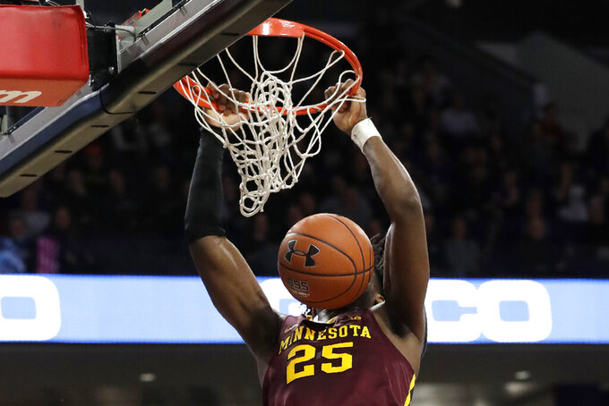 Minnesota center Daniel Oturu dunks against Northwestern during the first half of an NCAA college basketball game in Evanston, Ill., Sunday, Feb. 23, 2020. (AP Photo/Nam Y. Huh)