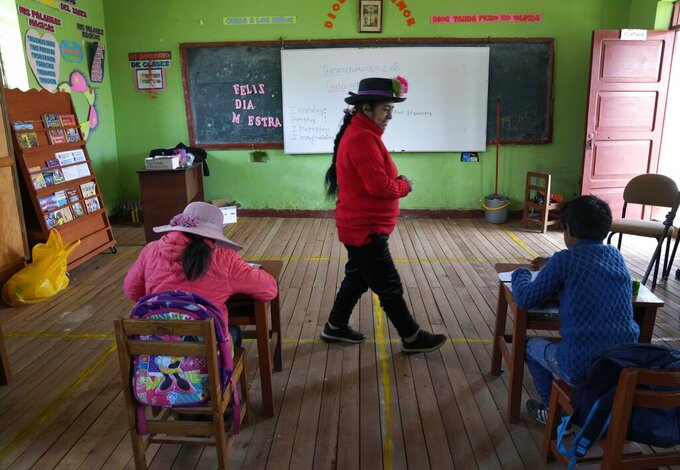 Alicia Cisneros teaches the Quechua Indigenous language to primary school students at a public school in Licapa, Peru, Wednesday, Sept. 1, 2021. Peru´s new Education Minister Juan Cadillo says the government aims to increase the number of bilingual teachers like Cisneros in public schools. (AP Photo/Martin Mejia)