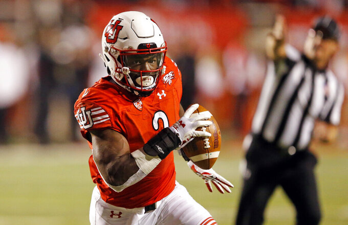 FILE - In this Oct. 20, 2018, file photo, Utah running back Zack Moss (2) carries the ball in the second half during an NCAA college football game against Southern California in Salt Lake City. The big question facing Utah when it hosts Oregon is whether Jason Shelley can pick up where Tyler Huntley left off. The Utes will need Shelley to adjust to his new role quickly after losing Moss to a knee injury. Moss suffered the injury at practice on Wednesday and now will require season-ending surgery. (AP Photo/Rick Bowmer, File)